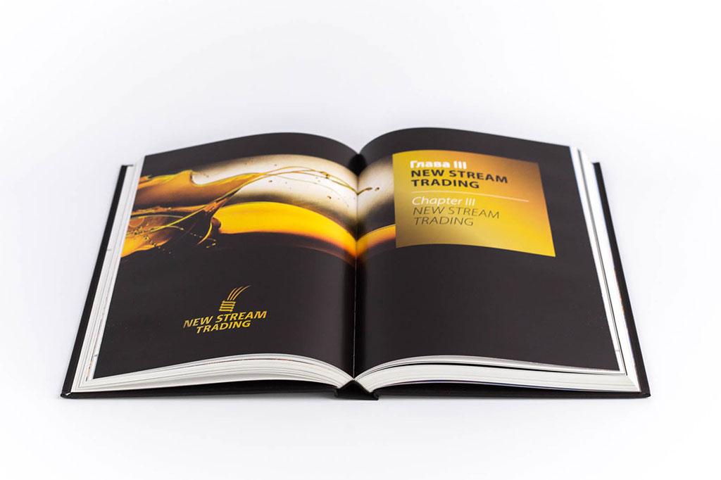 Дизайн разворота книги о предприятии группы компаний Новый поток